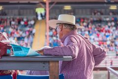 Man in cowboy hat watches the Williams Lake Stampede. Williams Lake, British Columbia/Canada - July 1, 2016: man in VIP stands watches the action in the arena Stock Photos