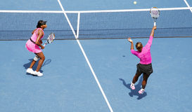 Williams sisters at US Open. Williams sisters Venus and Serena playing doubles at US Open 2009 stock photos