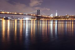 The Williamsburg bridge and Manhattan at night, New York royalty free stock images