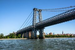 Williamsburg Bridge over the East River, Manhattan, NYC. View of the Willsburg Bridge from the East River, Manhattan, NYC stock images