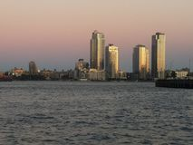 Williamsburg  Brooklyn skyscrapers at twilight with East River in foreground stock images