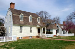 Williamsburg, VA: 1730 Co. John Taylor House. Circa 1750 wooden Colonel John Taylor House with its distinct high gambrel roof and window dormers (left), the Stock Photography