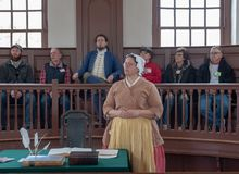 Mock Trial in Colonial Williamsburg. Williamsburg, VA, USA -- January 9, 2019. Actors in period costume, and surrounded by tourists, put on a mock trial in stock photography