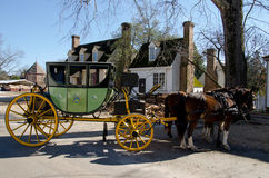Williamsburg, Virginia - historic coach with horses. Historic coach with horsemes on Duke of Gloucester  Street in Colonial Williamsburg, Virginia Royalty Free Stock Image