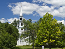 Williamstown Church Steple Amidst the Trees. The white steeple of First Congregational Church in Williamstown (c. 1765), Massahusetts on a beautiful summer's day Royalty Free Stock Images