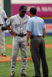 Willie Upshaw argues a call in a baseball game. CAMDEN, NJ - AUGUST 15: Bridgeport Bluefish manager, and former major leaguer, Willie Upshaw talks to the umpires stock photos