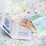 Willing to travel. Passport, money and a map on the table Royalty Free Stock Photos