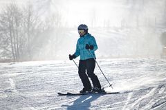 Willingen, Germany - February 7th, 2018 - Female skier in blue skiing suit on a ski run Royalty Free Stock Photos