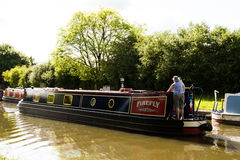 Willington Canal Boat. Canal boat cruising the Trent and Mersey Canal at willington Derbyshire Royalty Free Stock Image