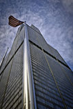 Willis (Sears) Tower and American flag in Chicago. Willis Tower (formerly Sears Tower) in Chicago, Illinois, with American flag flying in the foreground royalty free stock photography