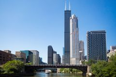 Willis Tower in Chicago on the Chicago River. The famous Willis Tower in Chicago, formerly known as Sears Tower, on a hot summer`s day in Chicago, Illinois, USA royalty free stock photo