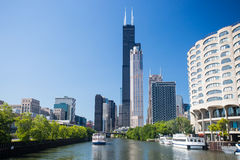 Willis Tower and the Chicago River. The famous Willis Tower in Chicago, formerly known as Sears Tower, on a hot summer's day in Chicago, Illinois, USA royalty free stock images