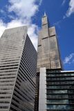 Willis Tower and other buildings in Chicago, Illinois. The Willis Tower stands tall over business buildings in Chicago, Illinois. The majestic building is over stock photography