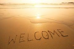 Willkommen, Beschaffenheit auf dem Strandsand Sea Stockbilder