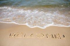 Willkommen geschrieben in sandigen Strand Lizenzfreies Stockfoto