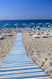 Willkommen zum blauen Strand Stockfotos