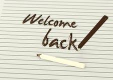 Willkommen zurück durch Schokoladenbleistifte auf Papier Lizenzfreie Stockfotos