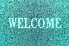 Willkommene cyan-blaue Tür-Matte Willkommener Teppich-Hintergrund Lizenzfreie Stockbilder