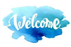 Willkommene Hand gezeichnete Beschriftung gegen Aquarell Stockbilder