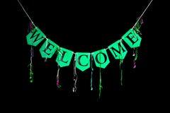 Willkommene Parteifahne Grüne mit dem Kopfe stoßende Buchstaben, die das Wortwillkommen buchstabieren lizenzfreie stockbilder