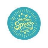 Willkommener Frühling Runder Stempel der Türkisfarbe mit einer gelben Aufschrift Stockbilder