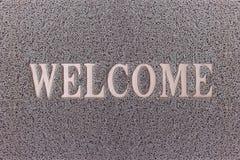 Willkommener Gray Door Mat Willkommener Teppich-Hintergrund Lizenzfreies Stockfoto