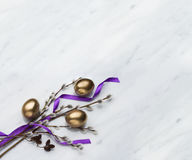 Willow and alder branches,  easter eggs on Carrara marble counte Stock Image