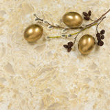 Willow and alder branches, gold eggs on Golden White quartz cou Stock Image