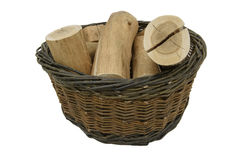 Willow Basket and logs Stock Photos