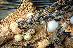 Willow branches and eggs on the table Royalty Free Stock Photography