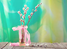 Willow branches with a pink tape in a transparent vase Stock Photo