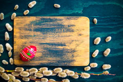 Willow catkins egg wooden board Royalty Free Stock Image