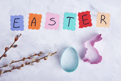 Willow and easter baking mold. Bunny, eggs and card. Congratulations on Easter royalty free stock images