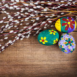 Willow and Easter eggs on rustic wooden planks Royalty Free Stock Image