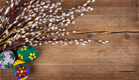 Willow and Easter eggs on rustic wooden planks Stock Images