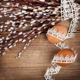 Willow and Easter eggs on rustic wooden planks Royalty Free Stock Photography