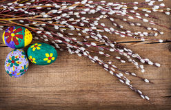 Willow and Easter eggs on rustic wooden planks Royalty Free Stock Photos