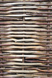 Willow Fence. Section of a fence woven from willow twigs Stock Photos