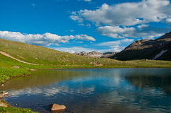 Willow lake near Mount Sneffels reflects the low atmosphere. 14er View from the Top of Mount Sneffels 14,150 Feet above sea level one of the highest mountain royalty free stock images