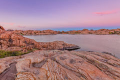 Willow Lake Sunset. A scenic of beautiful willow lake near prescott arizona with granite rock formations near sunset Stock Images