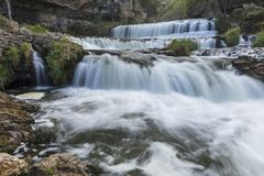 Willow River Waterfall. A large cascading waterfall in early autumn Stock Photo