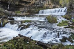 Willow River Waterfall. A large cascading waterfall in early autumn Royalty Free Stock Images