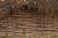 Willow wicker fence. A woven willow wicker fence panel suitable for gardening background or wallpaper. Copy space text Royalty Free Stock Images