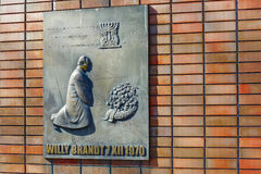 Willy Brandt commemorates the Ghetto Heroes. WARSAW, POLAND - MARCH 29, 2014: Bronze Plaque by W. Czechowska-Antoniewska, a part of unveiled Dec. 6, 2000 royalty free stock images