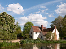 Willy Lott`s Cottage outside in flatford mill in constable count. Ry old and famous location building from a painting on a summer afternoon with no people very Royalty Free Stock Photography