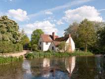 Willy Lott`s Cottage outside in flatford mill in constable count. Ry old and famous location building from a painting on a summer afternoon with no people very Stock Images