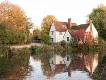 Willy lotts cottage at flatford mill in suffolk in autumn reflec Royalty Free Stock Photography