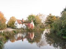 Willy lotts cottage at flatford mill in suffolk in autumn reflec Stock Images