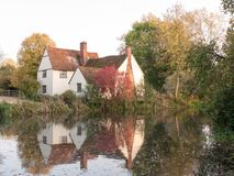 Willy lotts cottage at flatford mill in suffolk in autumn reflec Royalty Free Stock Photo
