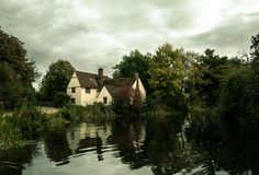 Dark Autumn Day English Country Mill Cottage House. Willy`s lott`s famous old white cottage house in flatford suffolk Royalty Free Stock Images